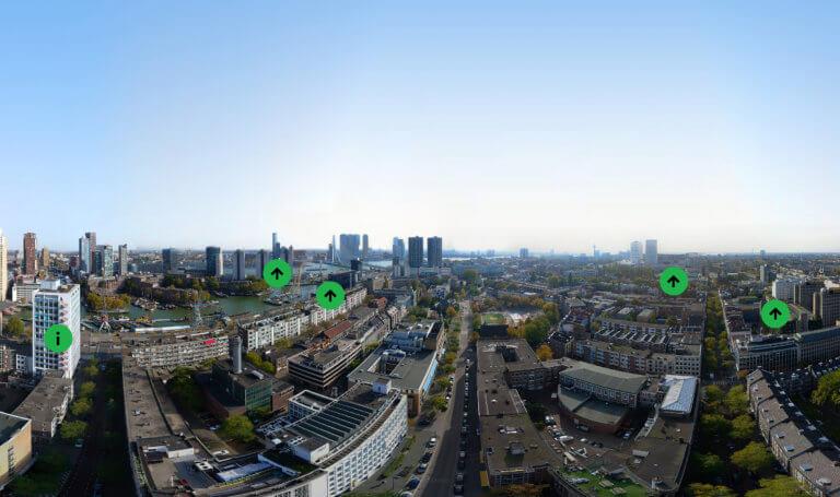 Skyline Rotterdam met groene punten er op
